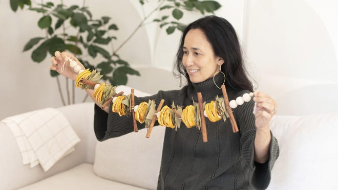 "San Francisco Bay-area based Mariam Naficy, founder of online design marketplace Minted, has been making garlands this year out of various materials, including fragrant dried orange slices. ""What I love about these is that they're stunning yet easy to make,"" she said. ""You can display on a mantle, bookcase, or drape one on your dining table surrounded by tea candles for a simple, aromatic centerpiece."""
