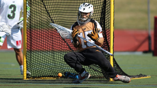 John Galloway makes a save for the Rochester Rattlers against the New York Lizards on Saturday at Aquinas.