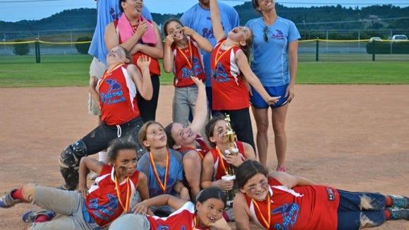 The Asheville Lady Braves 10U Butler/Norman softball team.