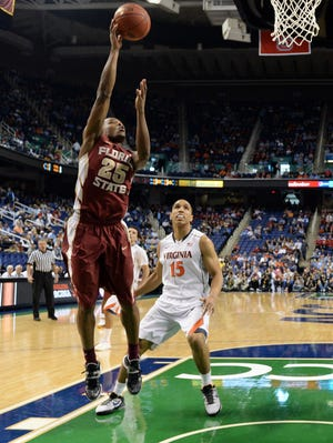 Florida State guard Aaron Thomas (25) goes up for a layup against the Virginia Cavaliers in the quarterfinals of the ACC college basketball tournament at Greensboro Coliseum.