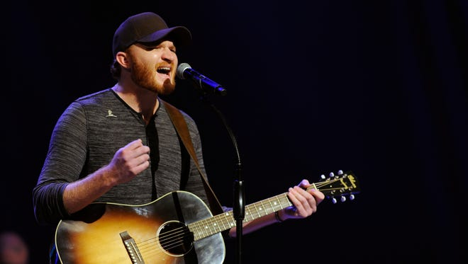 Eric Paslay performs Sept. 23, 2014, at St. Jude Kids Night at the Grand Ole Opry.