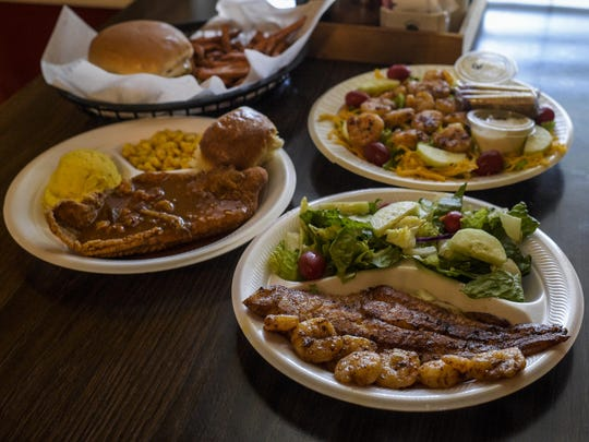 An assortment of plate lunch entrees are pictured at Veronica's Cafe in Carencro, Friday, Aug. 7, 2015.