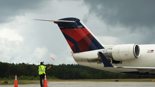 Grounds crew prepare a plane for departure at Worcester Regional Airport July 2.