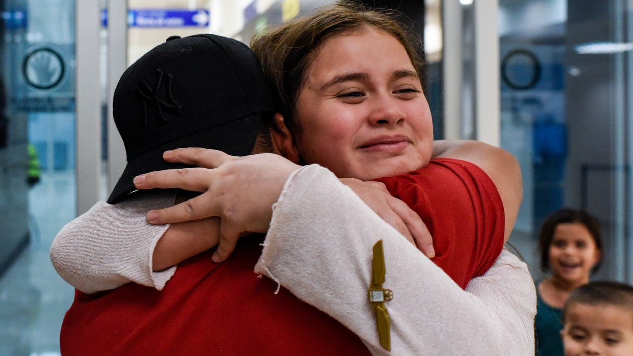 The four children of a deported Owensboro man are reunited with their father at the arrivals gate in Veracruz, Mexico.