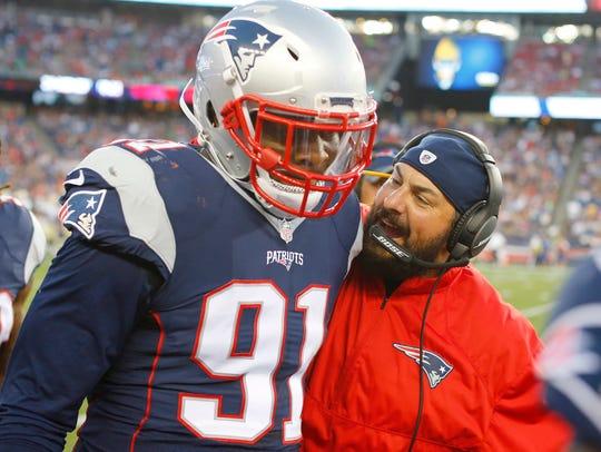 Patriots defensive coordinator Matt Patricia congratulates