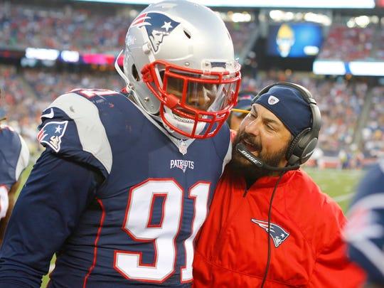 Patriots defensive coordinator Matt Patricia congratulates linebacker Jamie Collins, who scored a touchdown on an interception against the Saints in a preseason game Aug. 11, 2016 in Foxborough, Mass.