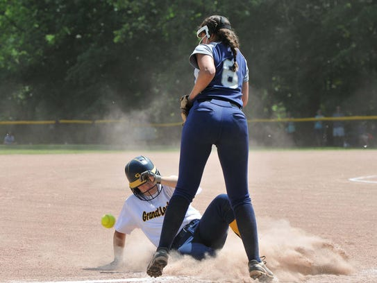 Lindsay Goodman from Grand Ledge beats the throw to
