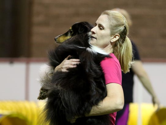 In this file photo, Jennifer Thomas carries Colt after finishing a run in the Obedience Training Club of Wichita Falls' agility trial June 17, 2017, at Kay Yeager Coliseum. Obedience Training Club of Wichita Falls' agility trial will be 8 to 4 p.m. Feb 17 and 18. Bridwell Ag Center