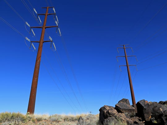 Electrical lines tower above the Black Knolls Trail in the Red Cliffs Desert Reserve, Feb. 16, 2015.