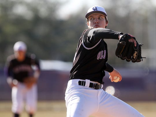 Old Bridge's Zach Attianese pitches against second-ranked Monroe, Wednesday, April 1, 2015, in Monroe, NJ.
