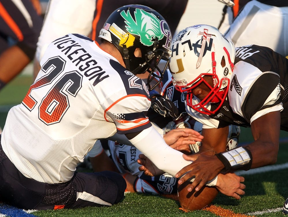 South Plainfield's Kyle Dickerson (26) recovers a second quarter fumble during Snapple Bowl XXII, Thursday, July 16, 2015, at Kean University in Union, NJ.