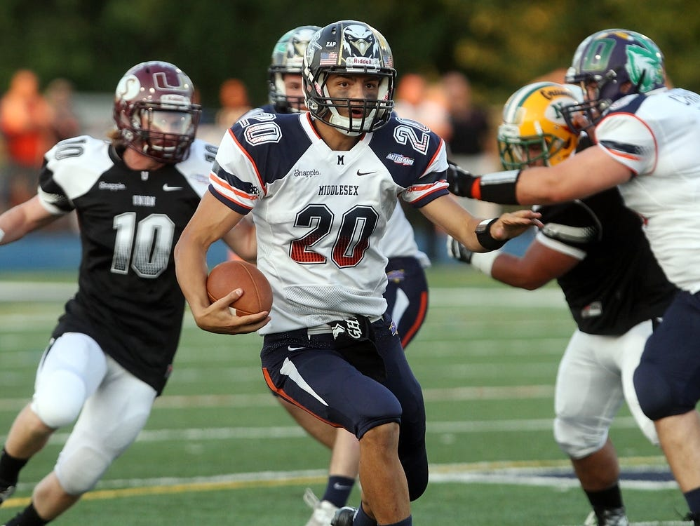 Middlesex County quarterback Mike Gargano, of Old Bridge, runs the ball during the second quarter.