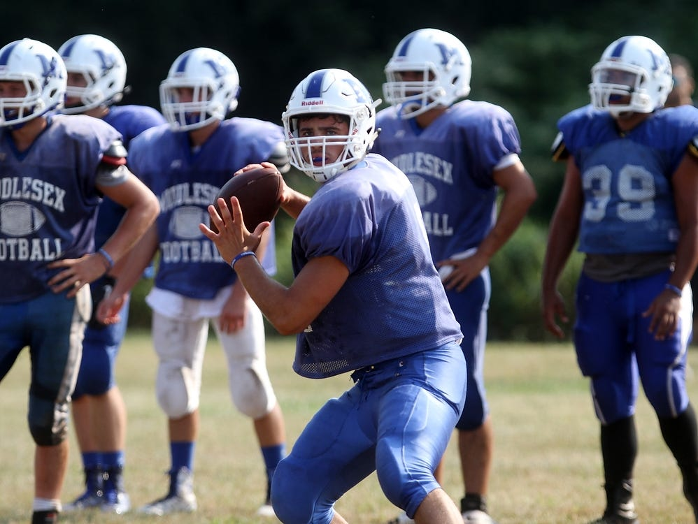 Middlesex quarterback AJ Abate throws during a preseason scrimmage against South Plainfield, Tuesday, August 18, 2015, in South Plainfield, NJ.