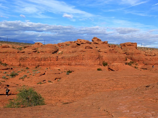 The cliffs of Pioneer Park and the Red Cliffs Desert Reserve can be seen northeast of the Sugarloaf.