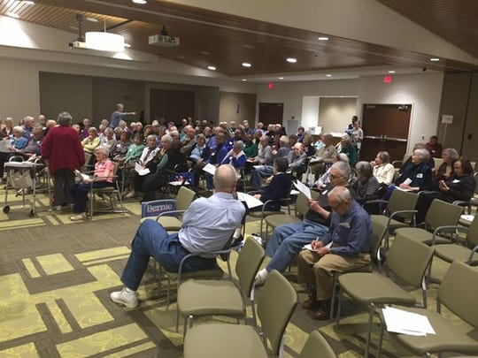 Residents of Oaknoll Retirement Center participate Monday is a satellite caucus in Iowa City.