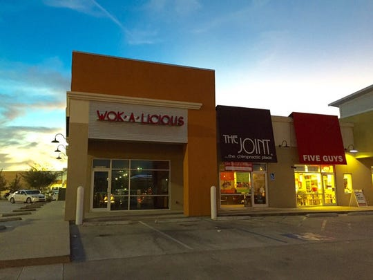 Wok-A-Licious is now open, located at  4302 Ambassador Parkway.