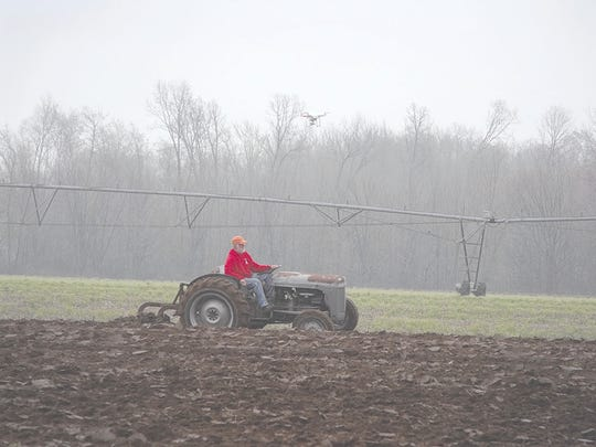Cork Babcock with his Ferguson was being recorded by a drone overhead during the Plow Day activities.