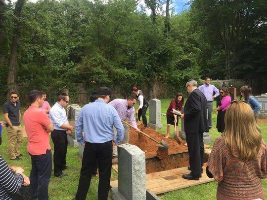 Rabbi Elchanan Weinbach leads a funeral service for