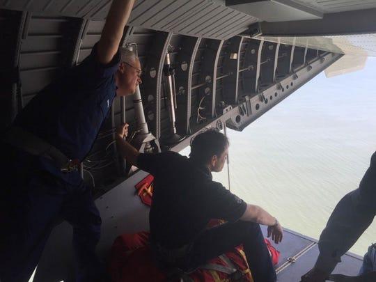 U.S. Coast Guard Rear Adm.Scott Buchman, left, and