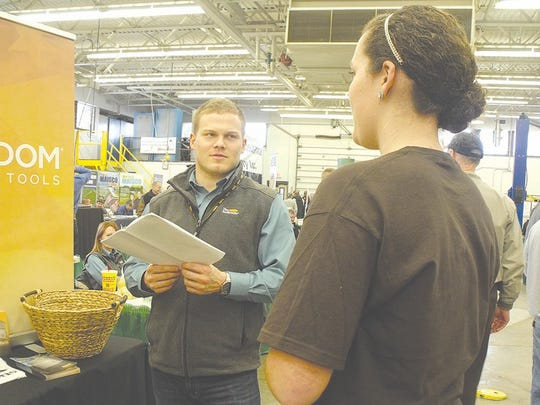 Reps from a variety of  agricultural based  companies interact with attendees in the vendor's hall during the daylong event.