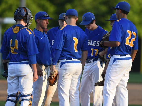 Jackson Christian's baseball couch Chuck Cooper talks to his team during their game, Monday, April 24, against Scotts Hill.