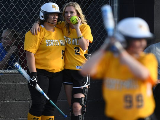 Scotts Hill's Caitlin Mitchell (9) and Chelsey Gore (2) talk to each other as Shayla Phillips (99) readies herself for a pitch during Wednesday's Region 8-A Championship game against Jackson Christian. Scotts Hill defeated Jackson Christian, 4-1.