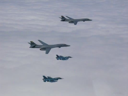 636378688003787756-B-1B-and-fighters.jpg