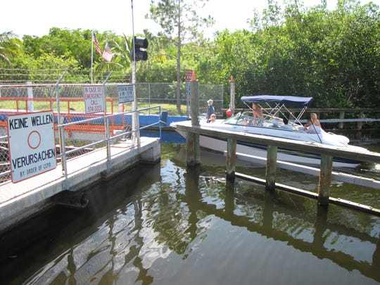 A boat approaches the Chiquita Lock in southwest Cape Coral. The city is planning to remove the structure and has the approval of the Florida Department of Protection.