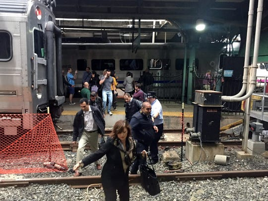 Passengers rush to safety after an NJ Transit train