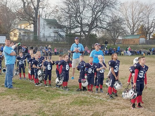 The Fairview Titan PeeWees line up to shake opponents'