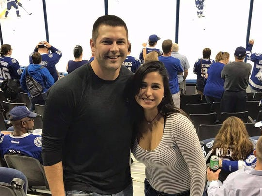 Kennya Gonzalez Ojeda and her boyfriend Vince Moore at a hockey game.