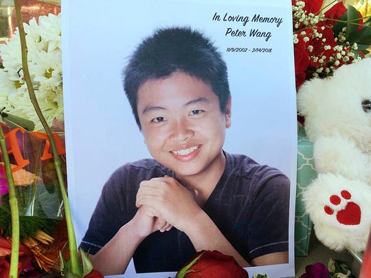 Peter Wang is seen in this photo near a memorial in Parkland, Fla., Friday, Feb. 16, 2018.