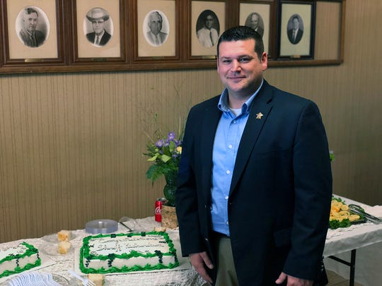 New DeSoto Parish Sheriff Jayson Richardson pauses to pause at a reception in his honor after  his swearing-in.