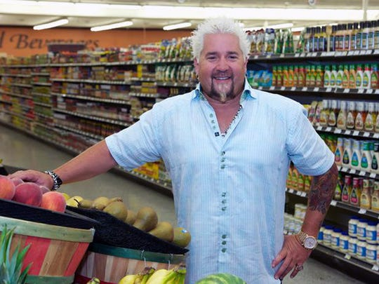 Host Guy Fieri poses during the taping of Food Network's