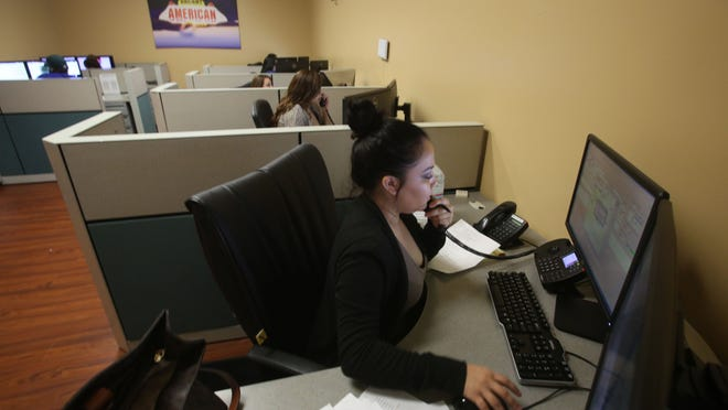 America Cab has hired 50 dispatchers for the Thousand Palms dispatch center. In this photo, Ysmene Villegas takes a call from a customer.