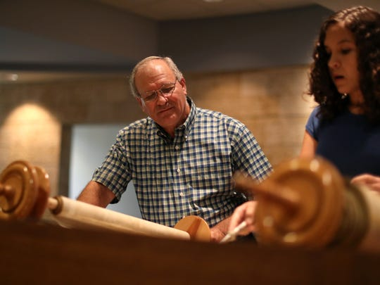 Rabbi Jack Romberg of Temple Israel helps his student Milye Krivit,14, as she practices her High Holy Day Torah reading a week before their Thursday ceremony.