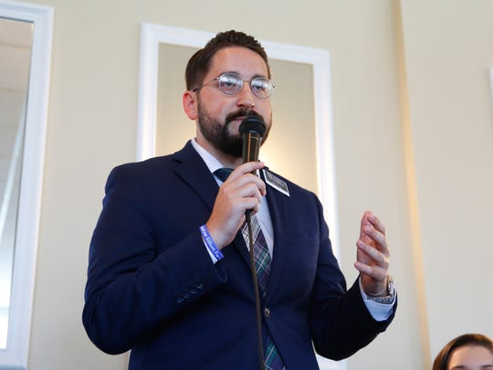 Tallahassee mayor candidate Dustin Daniels pitches his campaign platform to members of the Network of Entrepreneurs and Business Associates at the Capital City Country Club on Tuesday.