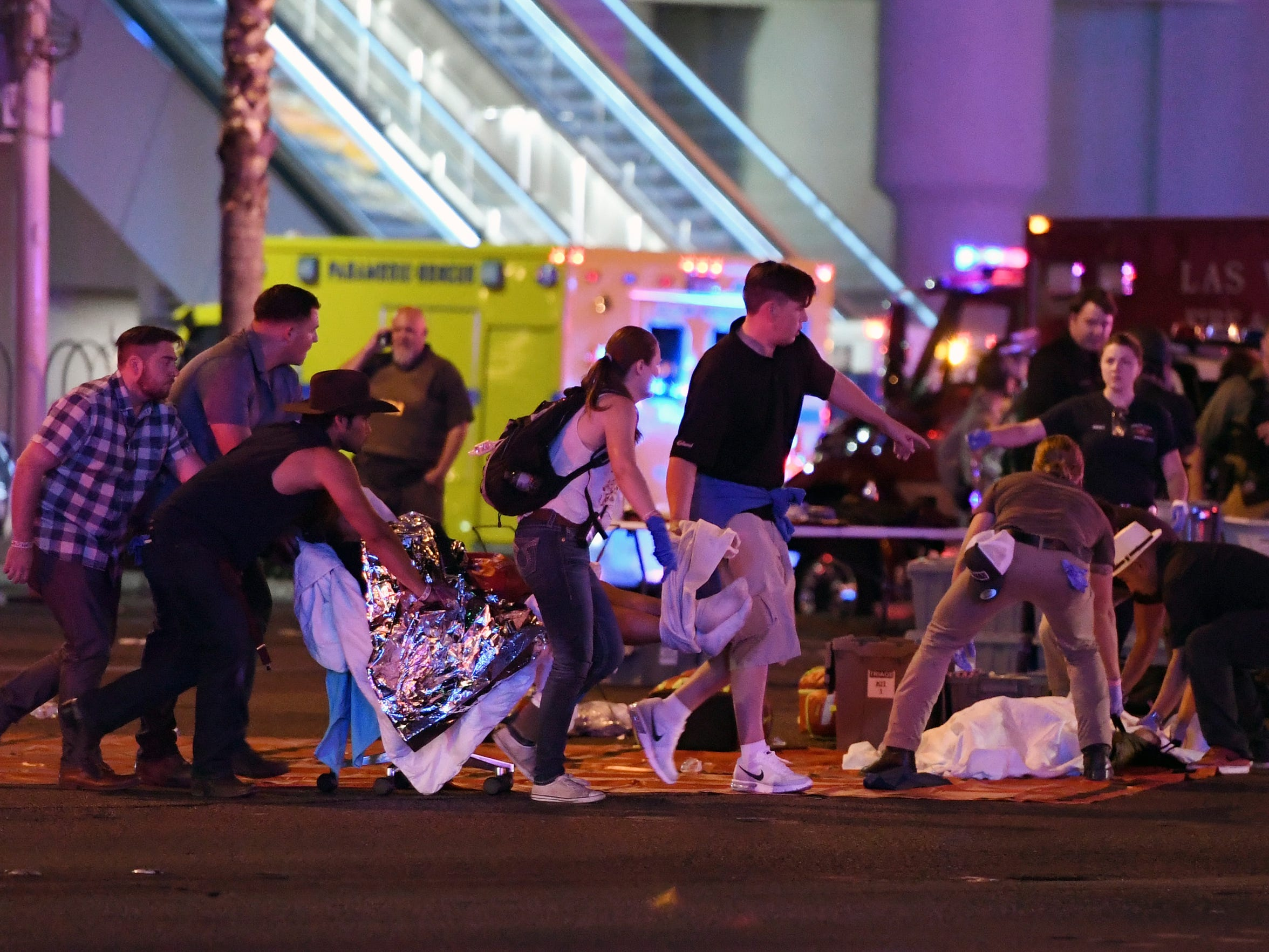 An injured person is tended to in the intersection of Tropicana Avenue and Las Vegas Boulevard after the shooting.