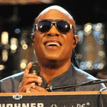 """Musican Stevie Wonder performs to announce his """"Songs in the Key of Life Performance"""" tour at Central Park SummerStage on Aug. 17, 2015, in New York City."""