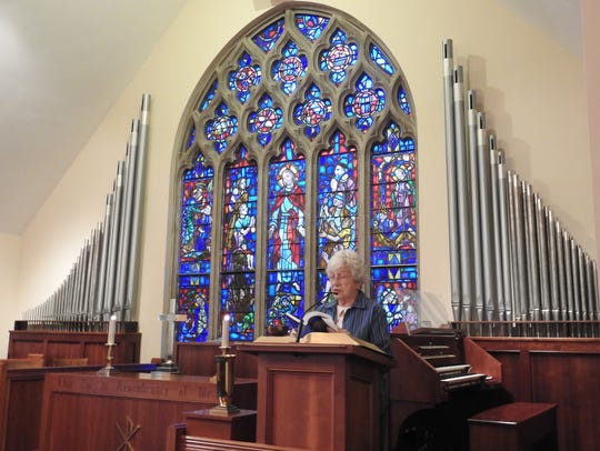 Norma Grewe reads scripture in Custer Chapel of Coshocton