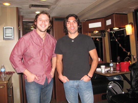 Brett Wilmer and Jason Morton of the country music duo The Cheaters, greets fans.