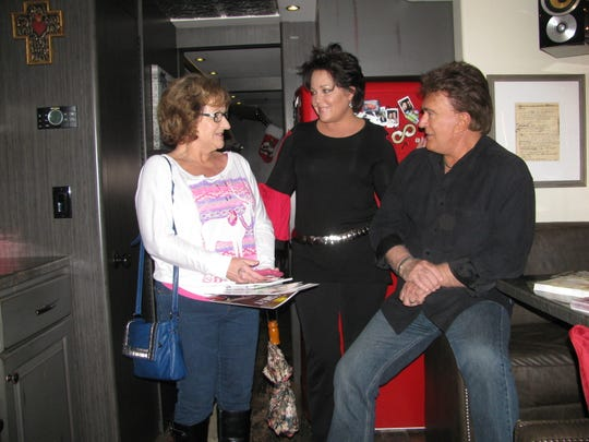 Renee Davis, left, of Westmoreland talks with country music entertainers Kelly Lang and T.G. Sheppard Monday during the Christmas 4 Kids Tour Bus Show. The event is held each year at the Hendersonville Walmart and benefits Christmas 4 Kids, a nonprofit group that helps underprivileged children at Christmas.