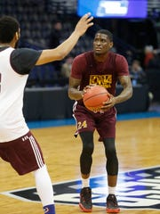 Iona guard A.J. English eyes the basket Wednesday,