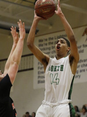 Oshkosh North High SchoolÕs Tyrese Haliburton puts up a shot on the inside against the Marshfield defense.  Oshkosh North takes on Marshfield in boys WIAA playoff action at Appleton North High school, March 9, 2017.  North beat Marshfield 67 - 54. Joe Sienkiewicz / USA TODAY NETWORK-Wisconsin