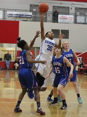 Summit guard Ravin Alexander slashes to the  basket. She finished with nine points and eight steals.