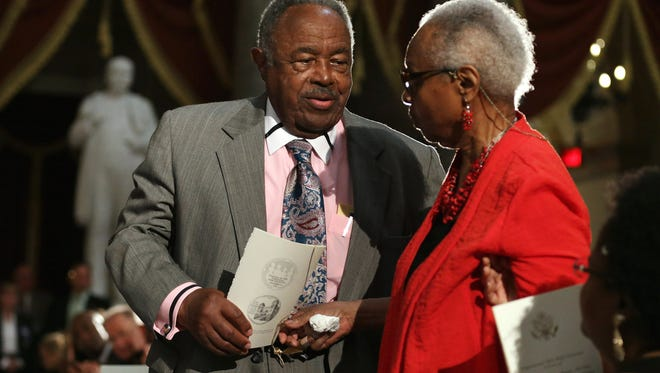 Jewell Chris McNair (left) and his wife Maxine McNair are acknowledged Sept. 10, 2013, during a ceremony in Washington where their daughter, Denise McNair, and three other girls were posthumously awarded the Congressional Gold Medal. Denise McNair, Addie Mae Collins, Carole Robertson and Cynthia Wesley were killed September 15, 1963, when members of the KKK bombed the Sixteenth Street Baptist Church in Birmingham, Ala. The medal honors the girls' sacrifice and how it served as a catalyst for the Civil Rights Movement.