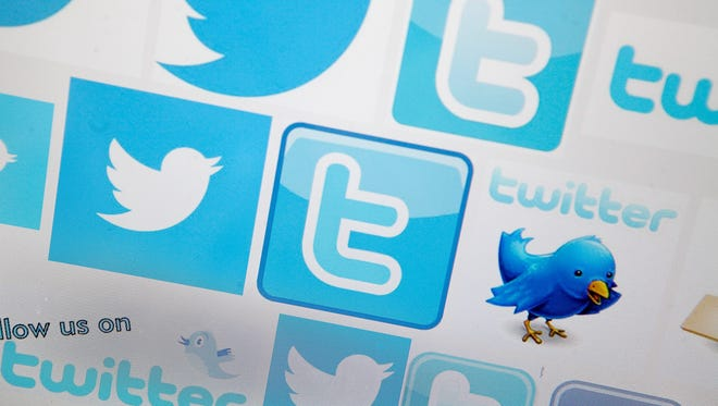 Logos for the microblogging site Twitter, displayed on the internet on Sept. 13 in London.