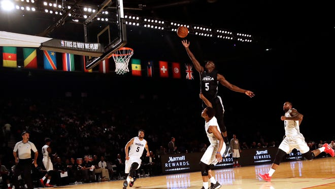 Team Africa's Victor Oladipo of Indiana Pacers, top, goes up to shoot during the NBA Africa Game between Team Africa and Team World, at the Dome in Johannesburg, South Africa, Saturday, Aug. 5, 2017.