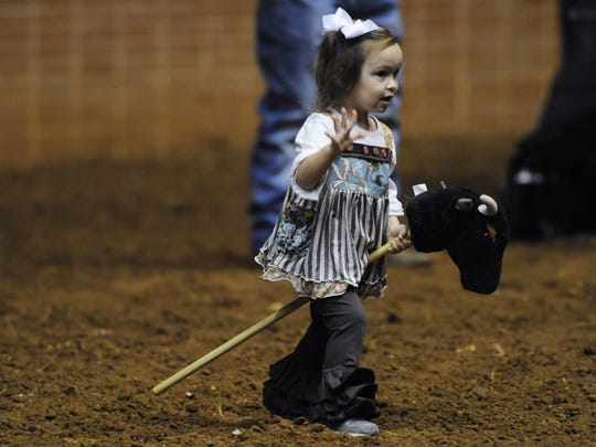 Kate Gambacurta rides in the stick horse rodeo before the SLE Rodeo at Garrett Coliseum in Montgomery, Ala. on Friday March 14, 2014.