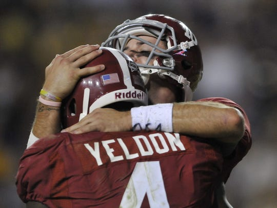 Alabama's A. J. McCarron (10) greets T. J. Yeldon (4) after Yeldon made their last touchdown in the fourth quarter of their game with LSU on Saturday, Nov. 3, 2012, in Baton Rouge, LA. (Montgomery Advertiser, Lloyd Gallman)